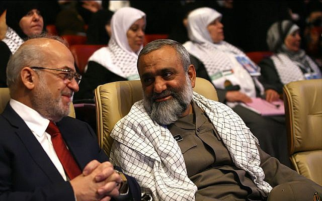 Mohammad Reza Naqdi, right, at a conference in Tehran in July 2012, sitting next to former Iraqi prime minister Ibrahim al-Jaafari. (Wikipedia/sayyed shahab-o-din vajedi/CC BY)