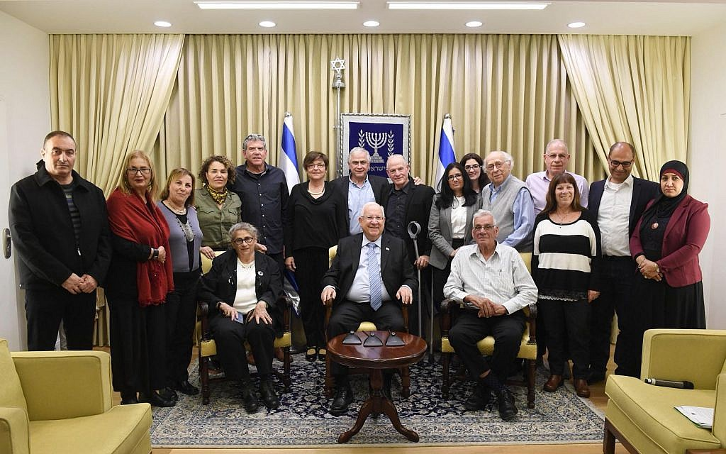 Israeli President Reuven Rivlin receives ERAN delegates at his residence, February 2018. Rivlin's daughter is a volunteer with ERAN. (Courtesy)