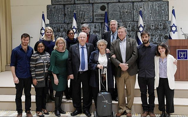 President Reuven Rivlin, center left, and his wife Nechama, center right, with bereaved family of crew members from the Columbia space shuttle disaster, January 27, 2019. (Amos Ben-Gershom/GPO)