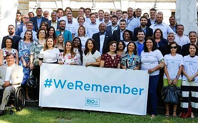 The mayor of the Brazilian city of Rio de Janeiro, Marcelo Crivella, poses for a picture with his municipal staff as part of the World Jewish Congress campaign ahead of International Holocaust Remembrance Day, January 18, 2019. (Courtesy via JTA)