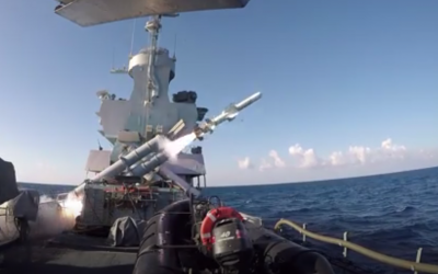 An Israeli Navy Sa'ar-4.5 corvette fires a Harpoon cruise missile at a decrepit cargo ship as part of an exercise in January 2019. (Screen capture: Israel Defense Forces)