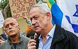 Former IDF chief of staff Benny Gantz seen with members of the Druze community and activists outside his home in Rosh Ha'ayin, during a protest against the nation-state law, January 14, 2019. (Flash90)