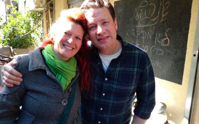 Nurit Goren (left) with UK chef Jamie Oliver,  in Tel Aviv's Carmel Market on Tuesday, January 29, 2019 (Courtesy Nurit Goren)