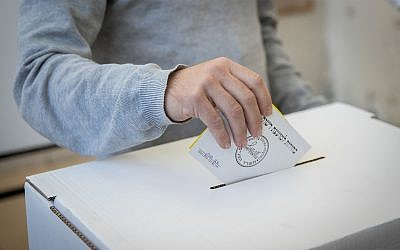 Illustrative: a man casts his ballot at a voting station in Israel's Municipal Elections, October 30, 2018, in Jerusalem. (Yonatan Sindel/Flash90)