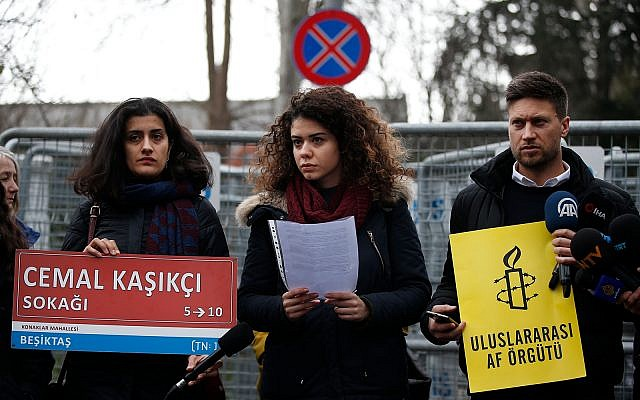 Members of Amnesty International stage a protest near the Saudi consulate in Istanbul, Thursday, January 10, 2019, marking the 100th day since Saudi journalist Jamal Khashoggi was killed in the kingdom's consulate. (AP Photo/Lefteris Pitarakis)