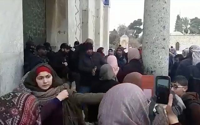 Muslim worshipers square off with police outside the Al-Aqsa Mosque in Jerusalem, January 14, 2019. (YouTube screenshot)