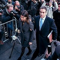 Michael Cohen, center, President Donald Trump's former lawyer, accompanied by his children Samantha, left, and Jake, right, arrives at federal court for his sentencing, December 12, 2018, in New York, for dodging taxes, lying to Congress and violating campaign finance laws. (AP Photo/Craig Ruttle)