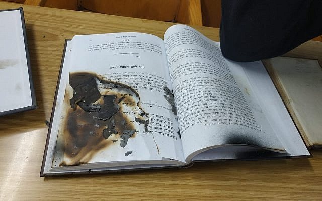 Burned prayer book found in Netanya synagogue after vandalism attack, January 27, 2019 (Police Spokesperson's Unit)