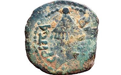 A 2000-year-old coin from the rule of Herod Agrippa, found in Nahal Shilo in the West Bank in January 2019. (COGAT)