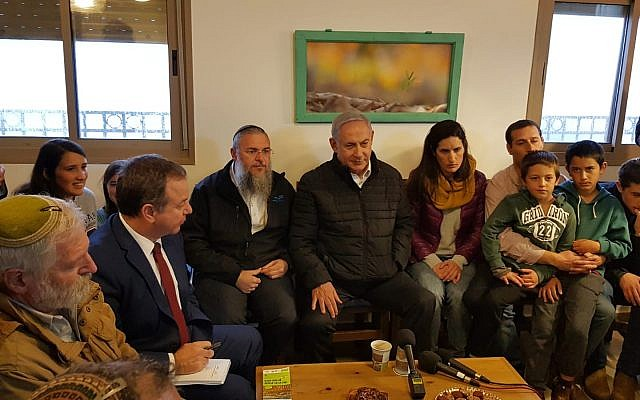 Prime Minister Benjamin Netanyahu (C) meeting families whose homes in the Netiv Ha'avot outpost were demolished last year, at the Elazar West Bank settlement, January 28, 2019. (Gush Etzion Regional Council)