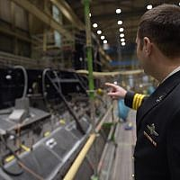 An Israeli Navy officer inspects the INS Dragon submarine currently being constructed in Kiel, Germany, in an undated photograph. (Israel Defense Forces)
