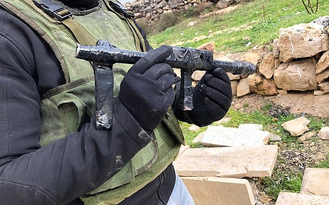 Soldiers confiscate guns allegedly used in a shooting attack on the West Bank settlement of Migdal Oz from a Palestinian village, on January 2019. (Israel Defense Forces)