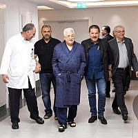 Palestinian Authority President Mahmoud Abbas, walking in a hospital, on May 21, 2018. (screen capture: Twitter)