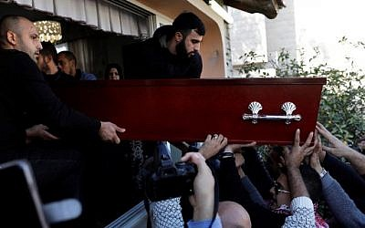 Mourners carry the coffin of Israeli student Aya Maasarwe during her funeral in the northern town of Baqa al-Gharbiya on January 23, 2019 (Ahmad GHARABLI/AFP)