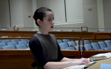 Batya Sperling Milner reads from Braille bible text (Washington Post video screenshot)