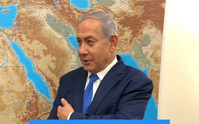 A still from Prime Minister Benjamin Netanyahu's video saying that elections, like an amputated arm, cannot be returned, January 5, 2019 (Screen grab via Facebook)