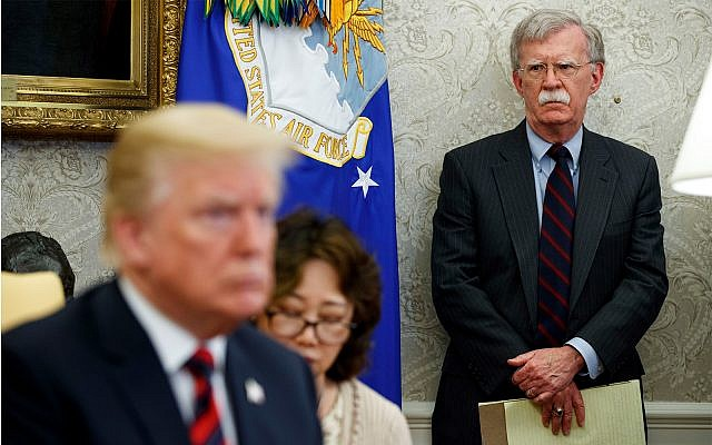 US President Donald Trump, left, meets with South Korean President Moon Jae-In in the Oval Office of the White House in Washington, as national security adviser John Bolton, right, watches. May 22, 2018. (AP Photo/Evan Vucci, File)