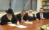 MKs Yaakov Litzman, Moshe Gafni, Meir Porush and Uri Makleff signing an agreement between Degel Hatorah and Agudat Yisrael to run in the April elections as the United Torah Judaism party, January 16, 2019. (Degel Hatorah)