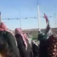 Palestinians climb on the Gaza border fence during riots on Friday January, 11, 2019 (Screencapture/Hadashot news)