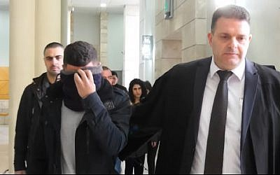 George Garib being led into Nazareth District Court January 29, 2019 for sentencing. Garib, 23, was handed a 5-year prison term for running over and killing police sergeant Natan Yossipov in 2016. (Screen Capture/ YouTube)