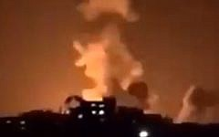An explosion in the northern Gaza Strip from Israeli airstrikes lights up the night sky on January 22, 2019. (Screen capture: Facebook)