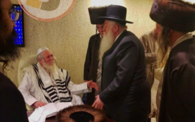 Rabbi Eliezer Berland (L), a convicted sex offender, meets with UTJ's Meir Porush at a Beit Shemesh wedding on January  6, 2019 (courtesy)