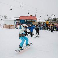 Visitors enjoy Mount Hermon's season opening, January 28, 2018. (Basel Awidat/Flash90)