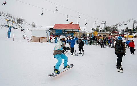 Visitors enjoy Mount Hermon's season opening, January 28, 2018. (Basel Awidat/Flash90)
