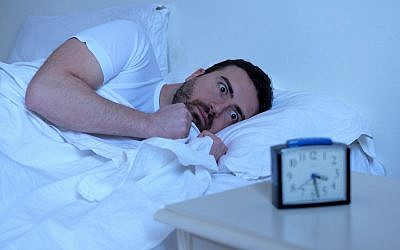 Illustrative image of a sleepless man (tommaso79; iStock by Getty Images)