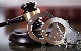 A gavel and handcuffs. (AndreyPopov/iStock by Getty Images)