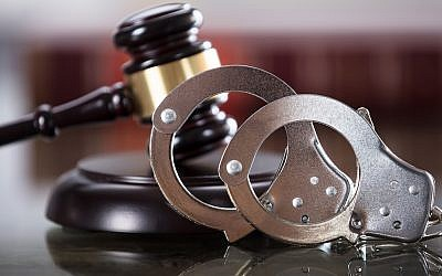 Illustrative: A gavel and handcuffs. (AndreyPopov/ Getty Images)