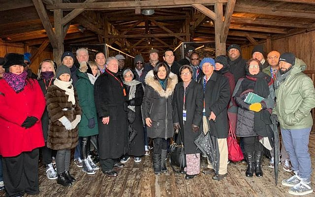 Israeli Ambassador to the UN Danny Danon is accompanied by fellow UN ambassadors during a tour of the Majdanek extermination camp in Poland, January 30, 2019. (Courtesy of American Zionist Movement)