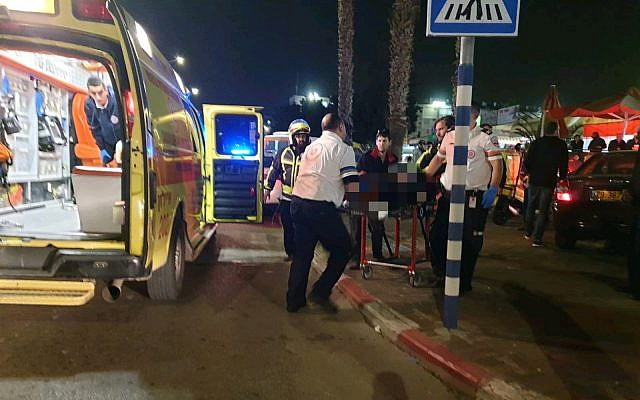 Archive photo: Stabbing victim in the city of Lod is evacuated by a Magen David Adom ambulance, January 24, 2019. (MDA)