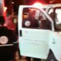 An ambulance in Kiryat Tivon, on January 28, 2019, after the shooting of a man by unknown assailants. (Channel 13 screenshot)