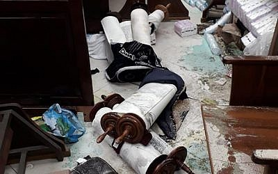 Torah scrolls thrown on the floor in Jerusalem synagogue attack, January 29, 2019 (Facebook)