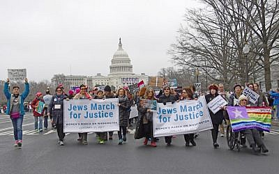 Supporters of the National Council of Jewish Women and other Jewish organizations come together on the National Mall for the Women's March in Washington, DC, January 21, 2017. (Ron Sachs via JTA)