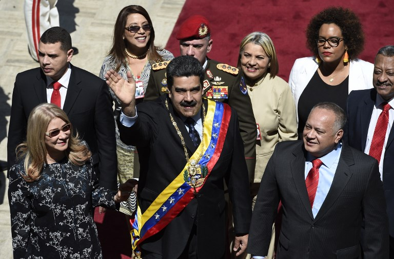 Venezuelan President Nicolas Maduro center his wife Cilia Flores left and the president of the Constituent Assembly Diosdado Cabello right arrive at the Federal Legislative Palace in Caracas