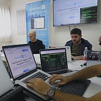 """Engineers from the Israeli company """"Commun.it"""" use their expertise in social media commercial analysis to identify networks of fake users, at their offices in the city of Bnei Brak near Tel Aviv on January 23, 2019 (JACK GUEZ / AFP)"""