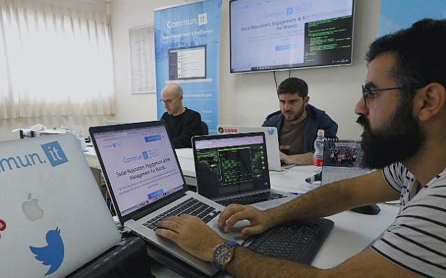 "Engineers from the Israeli company ""Commun.it"" use their expertise in social media commercial analysis to identify networks of fake users, at their offices in the city of Bnei Brak near Tel Aviv on January 23, 2019 (JACK GUEZ / AFP)"