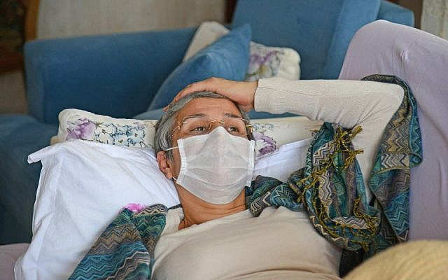 Pro-Kurdish Turkish MP Leyla Guven rests on a couch in her house in Diyarbakir, on January 30, 2019, as she continues her hunger strike. (Photo by ILYAS AKENGIN / AFP)