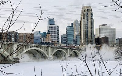 Water vapor rises above St. Anthony Falls on the Mississippi River beneath the Stone Arch Bridge during frigid temperatures on January 31, 2019 in Minneapolis, Minnesota. (Kerem Yucel / AFP)