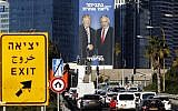 """A picture taken on February 3, 2019 in Tel Aviv shows a giant election billboard of Prime Minister Benjamin Netanyahu and US President Donald Trump shaking hands. The writing on the billboard reads """"Netanyahu, another league."""" (Jack Guez/AFP)"""