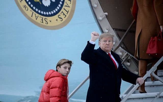 US President Donald Trump and son Barron Trump board Air Force One at Andrews Air Force Base in Maryland, en route to Palm Beach, Florida, on February 1, 2019. (Brendan Smialowski / AFP)