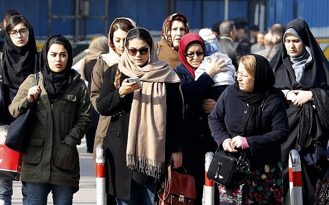 In this file photo taken on February 7, 2018, Iranian women wearing hijab walk down a street in the capital Tehran (ATTA KENARE / AFP)