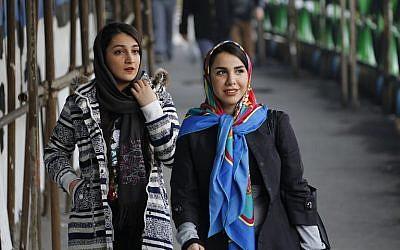 In this file photo taken on February 7, 2018, Iranian women wearing hijab walk down a street in the capital Tehran. (ATTA KENARE / AFP)