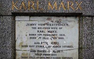The marble plaque showing damage from recent vandalism on the front of the tomb of German revolutionary philosopher Karl Marx, a Grade I-listed monument, is seen in Highgate Cemetery in north London on February 5, 2019. (Tolga Akmen/AFP)