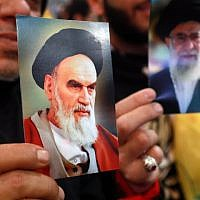 Hezbollah supporters hold images of the late founder of the Islamic Republic, Ayatollah Ruhollah Khomeini (L) and Iran's supreme leader Ayatollah Ali Khamenai, during celebrations marking the 40th anniversary of the Iranian revolution in Beirut on February 6, 2019. (ANWAR AMRO / AFP)