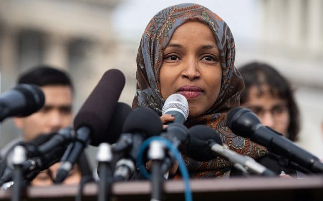 Democratic Representative Ilhan Omar of Minnesota speaks at a press conference calling on Congress to cut funding for US Immigration and Customs Enforcement and to defund border detention facilities, outside the US Capitol in Washington, on February 7, 2019. (Saul Loeb/AFP)