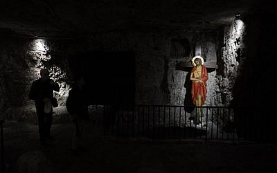 "A Christian worshiper visits the ""Prison of Christ"" in the church of Holy Monastery of the Praetorium, traditionally believed to be the site where Jesus was detained, in Jerusalem's Old City on February 8, 2019. (Thomas Coex/AFP)"