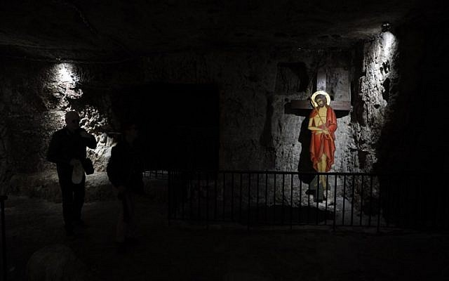 """A Christian worshiper visits the """"Prison of Christ"""" in the church of Holy Monastery of the Praetorium, traditionally believed to be the site where Jesus was detained, in Jerusalem's Old City on February 8, 2019. (Thomas Coex/AFP)"""